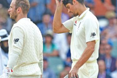 England's Alastair Cook is given out lbw to Nathan Lyon after a DRS challenge. AFP