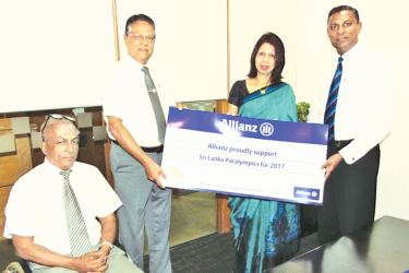 Handing over the sponsorship: From left - Brigadier Rajitha Ampemohotti (Immediate Past President, National Paralympic Committee), U. R. Rodrigo (President, National Paralympic Committee), Allianz Insurance Managing Director Surekha Alles