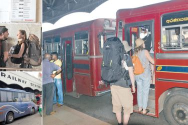 Thousands of train commuters including tourists were inconvenienced for the second day due to the strike launched by Railway trade unions. A special bus service was in operation at the Fort Railway station yesterday for passengers who had made reservations earlier.  Pictures by Wimal Karunathilake  and Thilak Perera