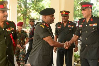 Army Commander Lieutenant General Mahesh Senanayake with former military spokesman and Chief Instructor of Defence Services Command and Staff College Sapugaskanda Brigadier Ruwan Wanigasooriya. Staff College Commadant Major General Ruwan Kulathunga is also in the picture.
