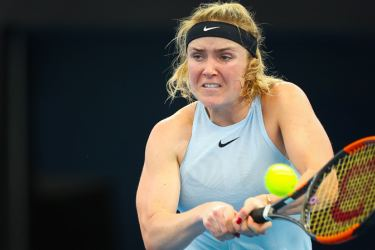 Elina Svitolina of Ukraine hits a return against Carla Suarez Navarro of Spain during their first round match at the Brisbane International tennis tournament at the Pat Rafter Arena in Brisbane on January 1. AFP