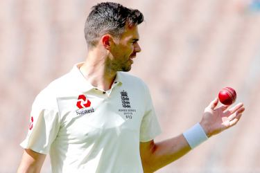 England's James Anderson catches the ball before bowling during the fifth day of the fourth Ashes cricket test match.