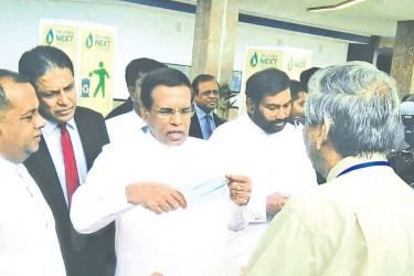 Mervyn Dias explaining to President Maithripala Sirisena about compostable and Biodegradable film at a recent exhibition in Colombo.