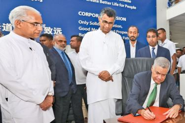 Prime Minister Ranil Wickremesinghe signing the visitor's book at the Colombo Port City premises. He made an inspection tour at the project site on Tuesday accompanied with Western Development and Megapolis Minister Patali Champika Ranawaka, Finance State Minister Eran Wickremaratne and Policy Planning and Economic Development Deputy Minister Dr Harsha de Silva. Picture by Hirantha Gunathilaka
