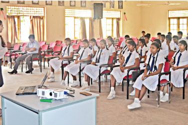 Students of two schools in the pilot programme receiving training by university students
