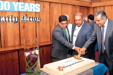 The Daily News celebrated its centenary at the Lake House boardroom with Media and Finance Minister Mangala Samaraweera joined by Lake House Chairman Krishantha Cooray and Daily News Editor Lalith Allahakkoon in cutting the centenary cake.