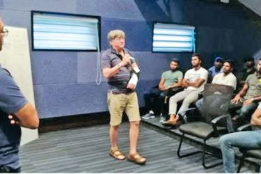 Dr Phil Jauncey addressing the Sri Lanka cricketers in the presence of head coach Chandika Hathurusingha (extreme left).