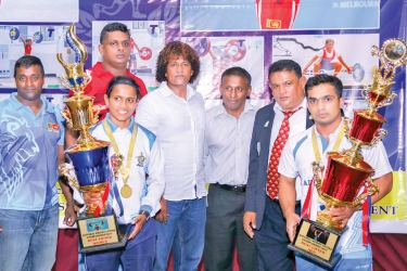 The National Weightlifting Championship 2017 was held at the headquarters of the Iron sport at Torrington Square on 28 and 29 December where Air Force emerged champions in both men and women categories. Picture shows the donor of all the trophies from Kandy WA Sampath Perera, a great iron sportsman and promoter with the best lifters award winners D.K.I.W.K. Palagasinghe (men's) and B.D.H. Gomes (women's).