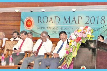 Central Bank Governor Dr Indrajit Coomaraswamy speaks at the presentation of Road Map 2018, last Wednesday. Picture by Saman Sri Wedage