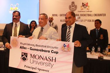 Jay Jayathileka - Director of Marketing (Monash University) with the sponsorship cheque (centre), Principal of Royal College and Dr. Harsha Alles Chairman of Gateway College are also present. Pic by Samantha Weerasiri