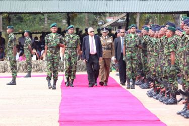 Prime Minister Ranil Wickremesinghe inspecting the guard of honour.