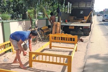 A bed being assembled by the roadside to sell to the public.