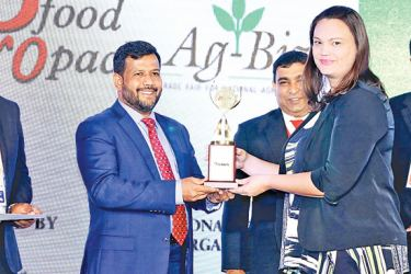 """Ma's Tropical Food Processing Manager, Sarah De Alwis receives the best award for """"All Food and Beverages"""" from the Industry and Commerce Minister Rishad Bathiudeen at the Pro Food-Pro Pack awards on February 27."""