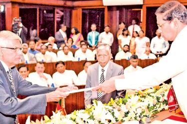 Prime Minister Ranil Wickremesinghe was sworn-in as Law and Order Minister before President Maithripala Sirisena at the Cabinet reshuffle held at the Presidential Secretariat last Sunday. (Picture courtesy Prime Minister's Media Division)