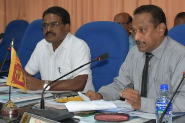 Batticaloa Government Agent M. Uthayakumar addressing the meeting, while Parliamentarian G. Srinesan looks on. Picture by Sivam Packiyanathan, Batticaloa Special Corr.