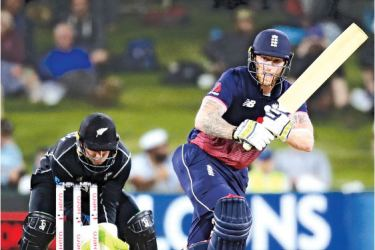 England's Ben Stokes bats watched by New Zealand's Tom Latham during the second one-day international (ODI) cricket match at the Bay Oval in Mount Maunganui on Wednesday. AFP