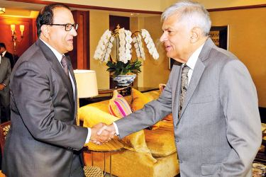 Strengthening trade ties between Sri Lanka and Singapore based on the Singapore-Sri Lanka Free Trade Agreement entered into this year became a focal point during the discussion between Prime Minister Ranil Wickremesinghe and Singapore's Trade and Industry Minister S. Iswaran. Picture shows  Prime Minister Wickremesinghe  being welcomed by Minister S.Iswaran. (Picture courtesy Prime Minister's Media Division)