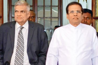 President Maithripala Sirisena and Prime Minister Ranil Wickremesinghe arriving at the Presidential Secretariat for the Cabinet reshuffle held recently. Picture by Sudath Silva