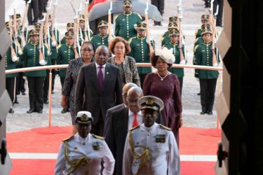 South Africa's President Cyril Ramaphosa arrives with South African Parliament Speaker Baleka Mbete (Right with hat)) and his wife and First Lady Tshepo Motsepe (Behind Right) to deliver his State of the Nation address on February 16, 2018. - AFP