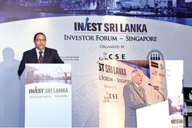 Minister for Trade and Industry of Singapore S. Iswaran and Prime Minister Ranil Wickremesinghe at the event