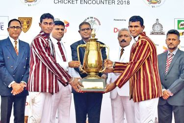 Upali Gajanayake - Group Chief Officer, Program Management and Tele Infrastructure, Dialog Axiata PLC hands over the Dr. N M Perera Trophy to the skippers Asel Sigera of Ananda College and Lakshitha Rasanjana of Nalanda College at the end of the 89th Battle of Maroons cricket encounter that ended in a draw at the SSC grounds yesterday. Manjula Wijemanne - Co-Chairman, Ananda College,  Thilak Waththuhewa - Principal, Nalanda College, S M Keerthiratne - Principal, Ananda College, and Mohan Gunadasa - Co-Chair