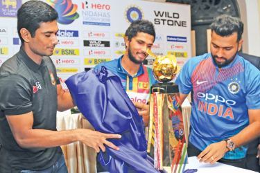 The three rival captains (from left) Mahmudullah (Bangladesh), Dinesh Chandimal (Sri Lanka) and Rohit Sharma (India) unveil the Hero Nidahas trophy which will be presented to the winner of the T20 Tri-series that commences at the R Premadasa Stadium today. Picture by Rukmal Gamage