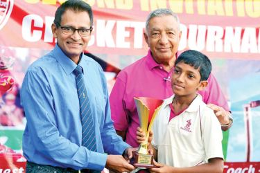 Player of the Tournament: Sharu Shanmuganathan (CCC School of Cricket) receiving the trophy from the chief guest Dilip Somaratne