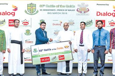 Nadina Fernando, Marketing Manager – Beverages, Elephant House presenting the sponsorship to Rev. Fr. Ranjith Andradi (Rector, St. Sebastian's College), and K. J. Fernando (Principal, Prince of Wales College). St. Sebastian's College cricket team captain Tharusha Fernando (far left) and Prince of Wales cricket captain Savindu Pieris (far right) and staffers from both schools are also present.