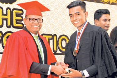 Students passing out from UCOL receive their awards from Manoj Munasinghe