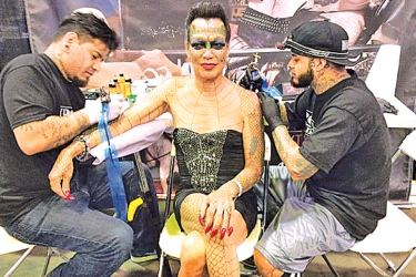 Tiamat with her 'Metamorphosis Team' tattoo artists, Rick Moreno and Drew De la Fuente at the New York Tattoo Convention