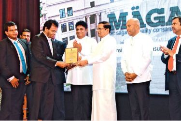 Chairman and Managing Director of Maga Engineering M.G. Kularatne receiving National Awards, for Construction Excellence for NSBM Green University project from President, Maithripala Sirisena. Also seen are Senior Project Manager (NSBM Project) Lochana Udawatta (Left), Minister of Housing and Construction  Sajith Premadasa and Deputy Minister of Housing and Construction Indika Bandaranayake.