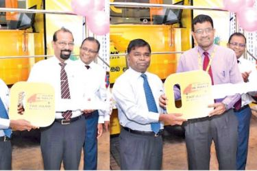 The Bank's General Manager MR. D.M. Gunasekera handing over the vehicles to Assistant General Manager Northern Province M.J. Prabaharan and Assistant General Manager Sabaragamuwa Province H.M.M.B Herath .