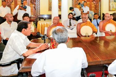 President Maithripala Sirisena addressing a special meeting with religious and political leaders, government officials and security authorities at President's House in Kandy yesterday. Picture by Chandana Perera