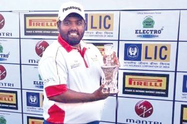 Mithun Perera with the Chennai Open winners' trophy