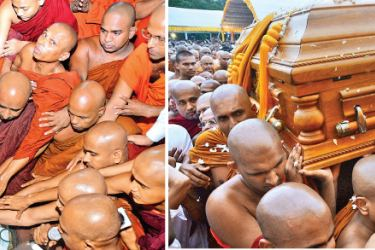 Religious observances by monks at the funeral. The casket of the late thera being carried to the pyre by the monks. Pictures by Sudath Malaweera