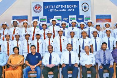 Jaffna Central College (red ties) and St. John's College Jaffna cricket teams with school officials.
