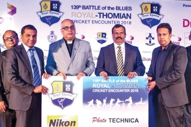 Harsha Malvenna, CEO Photo Technica (Pvt) Ltd (extreme left) and Manusha Wickramasinghe, Chief Operating Officer (COO) (extreme right) handing over the sponsorship cheque to Revd. Marc Billimoria, Warden S. Thomas' College Mount Lavinia (second from left) and Mr. B. A. Abeyratne, Principal Royal College.