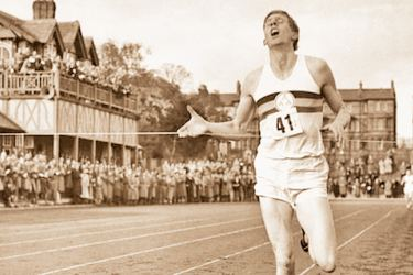Bannister breaks the tape to become the first man ever to break  the four-minute barrier in the mile at Iffly Field in Oxford