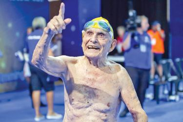 George Corones, who turns 100 next month, celebrates his feats on the Gold Coast. AFP
