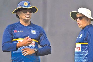 Fast bowling coach Rumesh Ratnayake (left) with head coach Chandika Hathurusingha during practices.