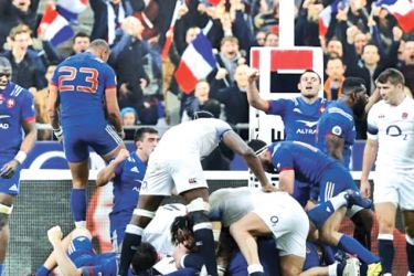 French players celebrate at the end of the match against England.