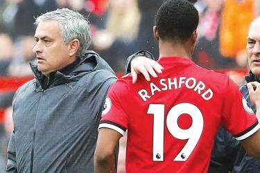 Manchester United manager Jose Mourinho with Marcus Rashford as he is substituted.
