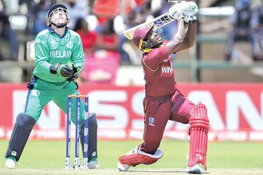 West Indies batsman Rovman Powell powers his way towards a century against Ireland at Harare SC.