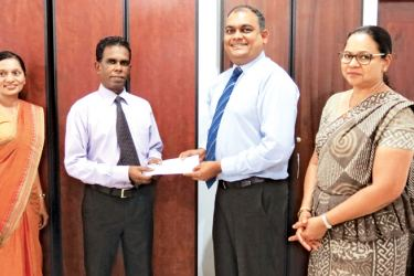 At the presentation of the sponsorship cheque are (from left) Dr. Tharusha Gooneratne, Head, Department of Accounting and Dr Pradeep Dharmadasa, Dean - Faculty of Management and Finance of the University of Colombo, with Hasrath Munasinghe, Deputy General Manager, Marketing of Commercial Bank and Priyanthi Perera, the Bank's Head of Operations.