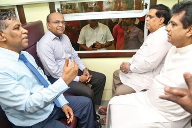 Transport and Civil Aviation Minister Nimal Siripala de Silva with  Deputy Minister Ashok Abeysinghe takes the first journey on the locally refurbished train on March 31.
