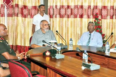 Northern Province Chief Minister C.V. Vigneswaran and Army Commander Lieutenant General Mahesh Senanayake with other officials, at the meeting in Nallur on Thursday.