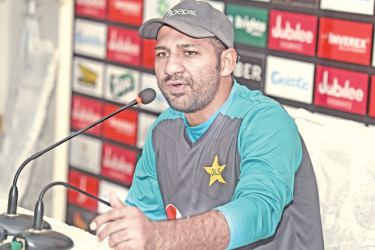 Pakistan cricket team captain Sarfraz Ahmed addresses a press briefing at the National Cricket Stadium in Karachi on Saturday. Sarfraz showed gratitude to West Indies team on touring his cricket drought country, hoping they give good feedback to other teams for more international matches. - AFP
