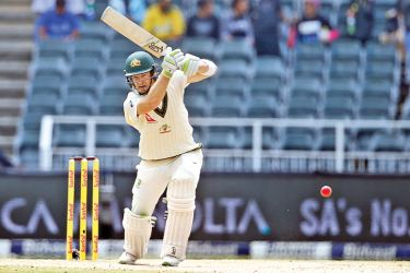 Australian batsman Tim Pain plays a shot on the third day of the fourth Test cricket match between South Africa and Australia won by South Africa at Wanderers cricket ground on April 1. AFP