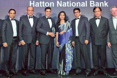 Sanjay Wijemanne, Deputy General Manager, Retail Banking, HNB with the Award. Also in the picture from left: Foo Boon Ping, Managing Editor, The Asian Banker, Niluka Amarasinghe, Vinodh Fernando, Dilanka De Silva, Mangala Wickramasinghe of HNB and other officals.
