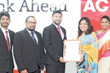 The Approved Employer Status Certification being handed over by Head of ACCA Sri Lanka Nilusha Ranasinghe to Suneth Silva, Director of WIS